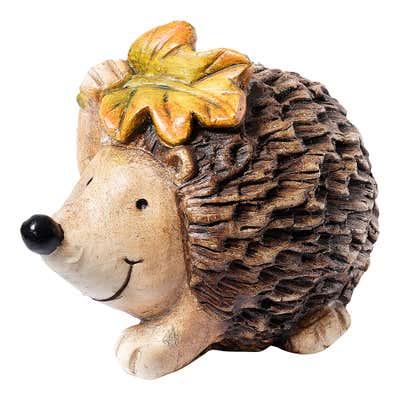 Igel-Figur mit hübschem Herbst-Laub